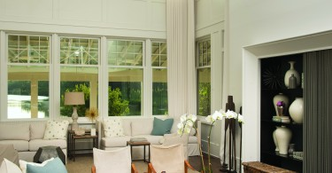 large, high ceiling, painted white, with nice, well placed furniture throughout the room